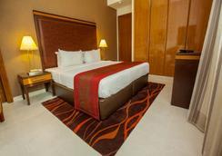 Xclusive Hotel Apartments - Dubai - Kamar Tidur