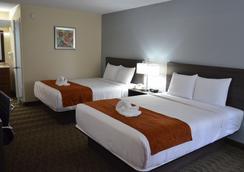 Days Inn & Suites Orlando Airport - Orlando - Kamar Tidur