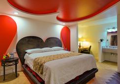 Romantic Inn & Suites - Dallas - Kamar Tidur