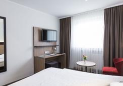 Astor & Aparthotel - Köln - Kamar Tidur