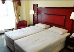New Penninsula Hotel - Dubai - Kamar Tidur