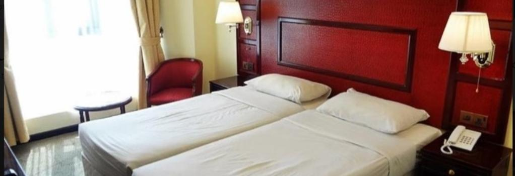 New Penninsula Hotel - Dubai - Bedroom