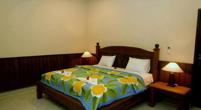 Puri Rai Hotel - Manggis - Bedroom