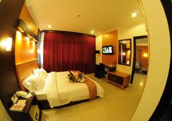 Hotel Swarna Dwipa - Kota Palembang - Kamar Tidur