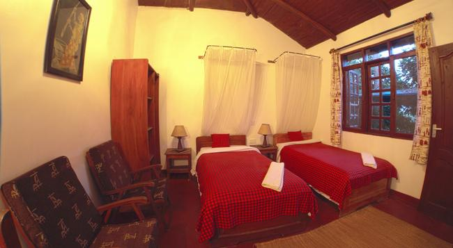 Safariland Cottages - Arusha - Bedroom