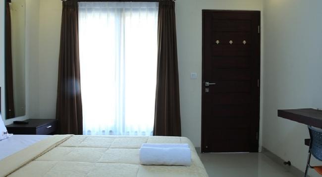 Reddoorz @ Pura Demak Marlboro - Denpasar - Bedroom