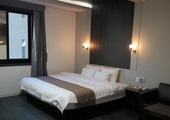 Seattle B Hotel - Busan - Kamar Tidur