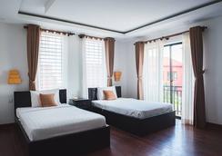 Bella Mia Angkor Villa - Siem Reap - Kamar Tidur