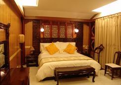 Lijiang Dian Jun Wang Hotel - Lijiang - Kamar Tidur
