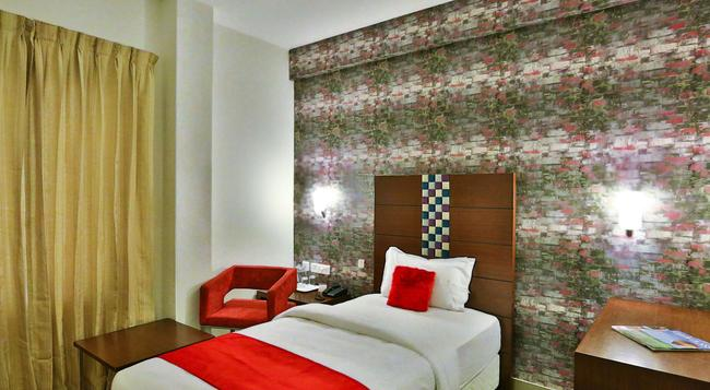 Hotel Vels Grand Inn - Coimbatore - Bedroom