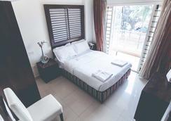 Royal Suites Hotel Apartments - Bengaluru - Kamar Tidur