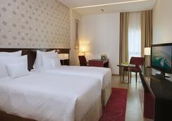 Cosmopolitan Hotel - Dubai - Kamar Tidur