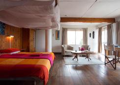Q-bar & Guest House - Dar Es Salaam - Kamar Tidur