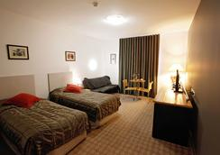 Golden Pebble Hotel - Melbourne - Kamar Tidur