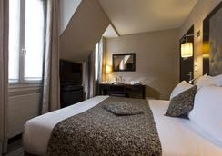 Hotel Elysees Bassano - Paris - Kamar Tidur