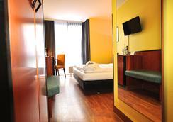 Golden Leaf Hotel Stuttgart Airport & Messe - Stuttgart - Kamar Tidur