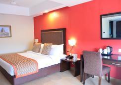 The Cloud Hotel - Ahmedabad - Kamar Tidur