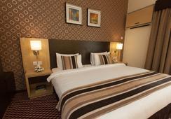Fortune Karama Hotel - Dubai - Kamar Tidur