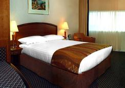 Adhari Hotel - Al-Manamah - Kamar Tidur