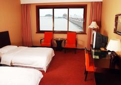 Qingdao Huaneng Hotel - Qingdao - Kamar Tidur