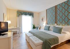 Lago Garden Apart-Suites & Spa Hotel - Cala Ratjada - Kamar Tidur