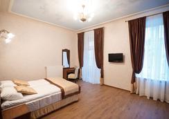 Guest House Inn Lviv - Lviv - Kamar Tidur