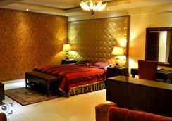 Envoy Continental Hotel - Islamabad - Kamar Tidur