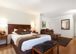 Apart Hotel Cambiaso - Santiago - Kamar Tidur